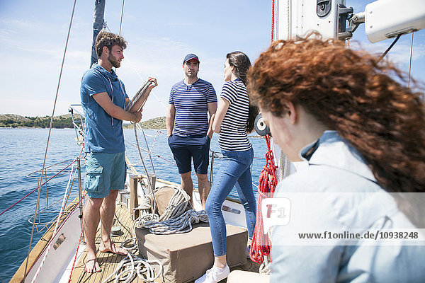 Group of friends on deck of sailboat