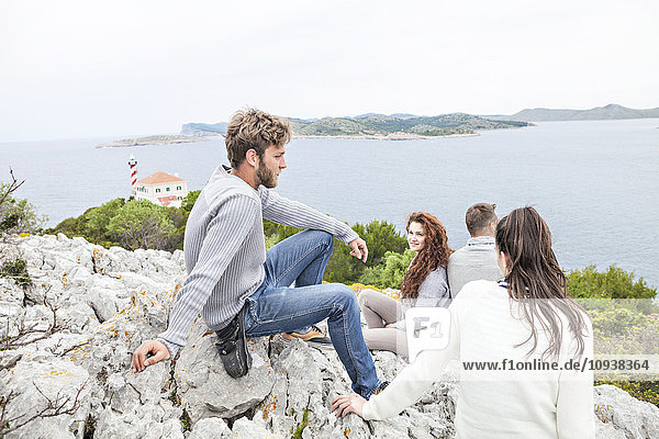 Group of friends taking a break at the seaside