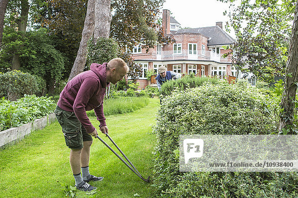 Man with pruning shears in garden