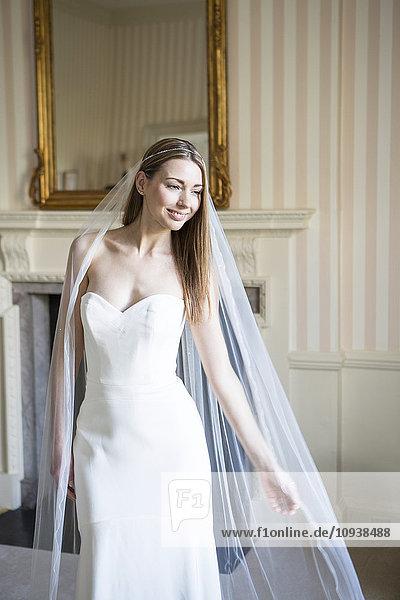 Bride showing off wedding dress