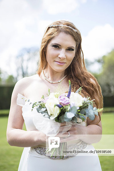 Portrait of bride with bouquet in hands