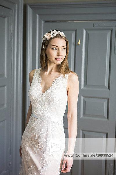 Happy bride showing off wedding dress