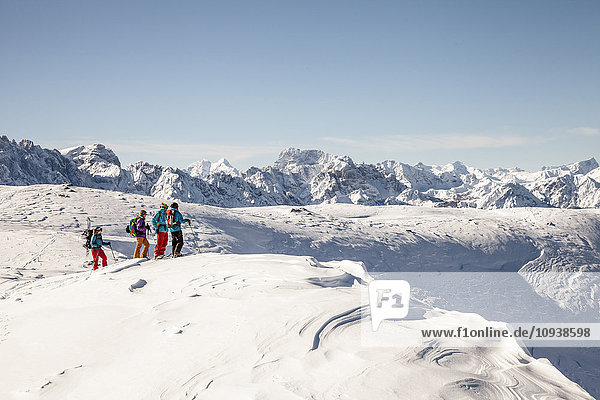 Group of skitourers walking in Sexten Dolomites