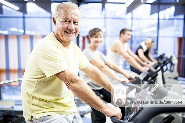 Man exercising stationary bicycle
