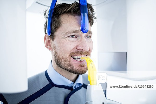 Mid Adult man having dental x-ray