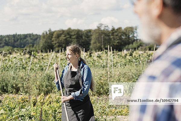 Female farmer with man in organic farm