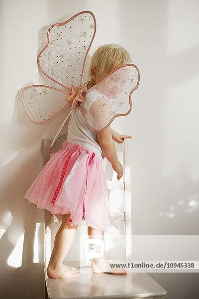 Sweden  Skane  girl (4-5) wearing fairy costume Sweden, Skane, girl (4-5) wearing fairy costume
