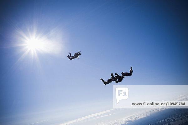 Four people parachuting