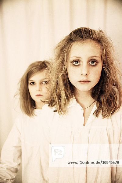 Portrait of two girls in halloween make-up