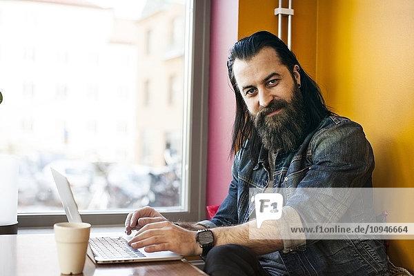 Portrait of man using laptop