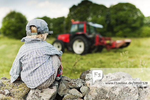 Boy looking at tractor