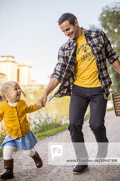 Father walking with girl