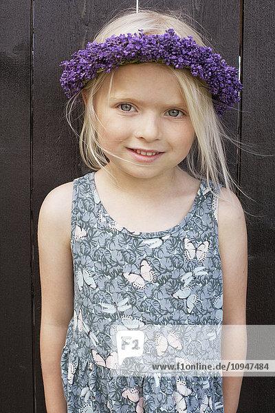 Girl wearing purple wreath