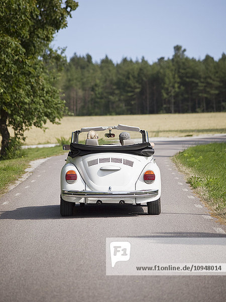 Couple in convertible car  rear view