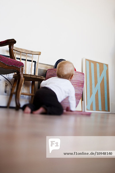 Close up of baby boy crawling on floor
