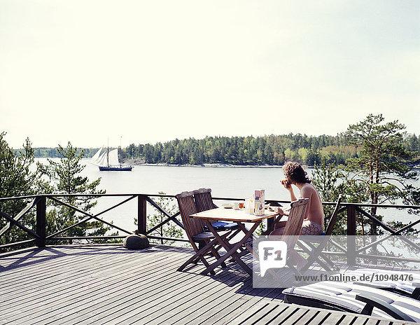 Man eating breakfast on terrace