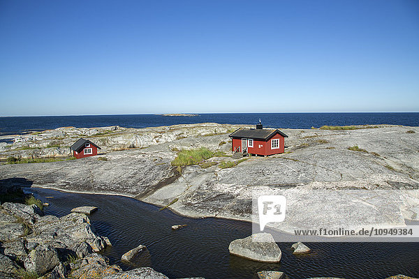 Wooden houses on rocky coast