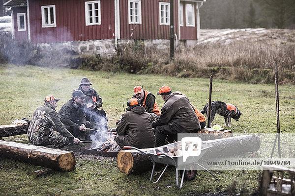 Hunters at campfire
