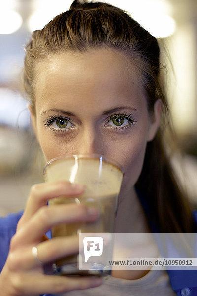 Woman drinking coffee  portrait
