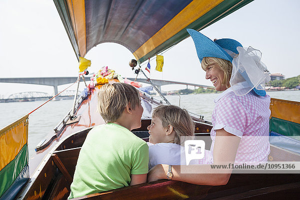 Mother with sons on boat