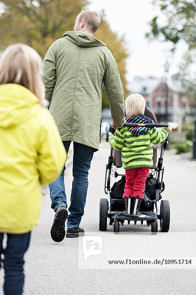 Father walking with children