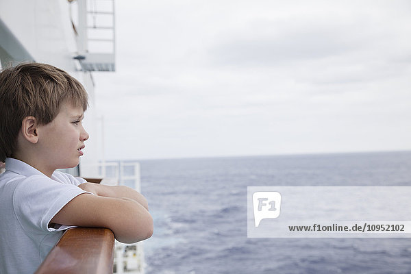 Boy on ferry looking at sea