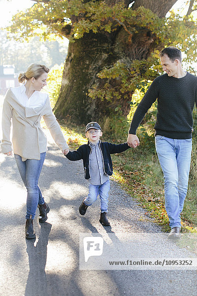 Parents walking with son