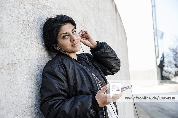 Mid adult woman with cell phone
