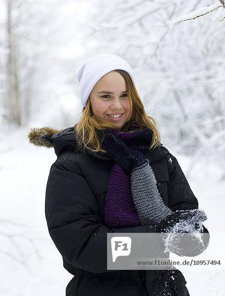 Teenage girl making snow balls  Sweden.