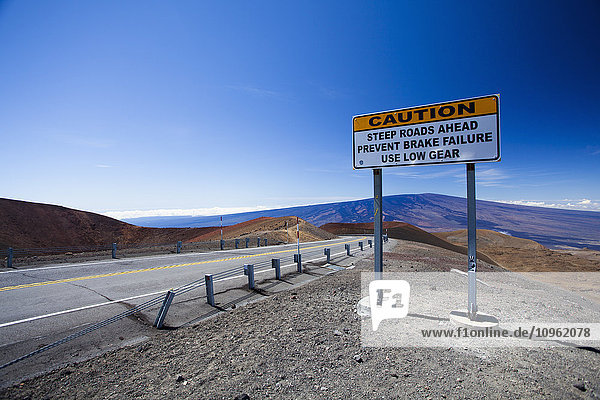 'Caution sign along roadside towards Mauna Kea; Island of Hawaii  Hawaii  United States of America'