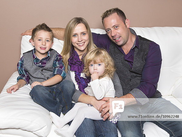 'Family portrait with young mother who is disabled; Spruce Grove  Alberta  Canada'