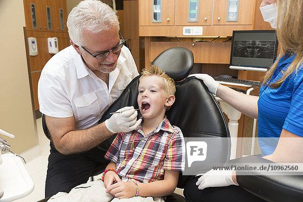 'A young boy at a dental examination; Edmonton  Alberta  Canada'