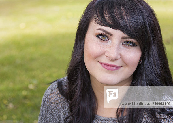 'Portrait of a beautiful young woman outdoors in a city park in autumn; St. Albert  Alberta  Canada'
