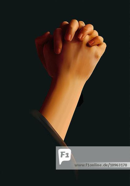 Hands folded in prayer against a black background