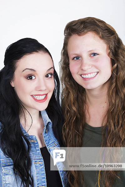 'Portrait of two young women with exaggerated smiles; Alberta  Canada'