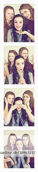 'Three young women creating photo booth series of images in filmstrip format; Alberta  Canada'