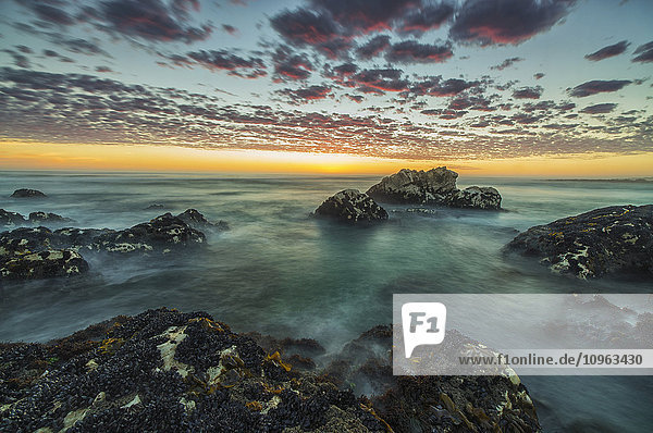 'Red clouds of sunset over the ocean along the coast of South Africa near Hondeklip Bay; Namakwa  South Africa'