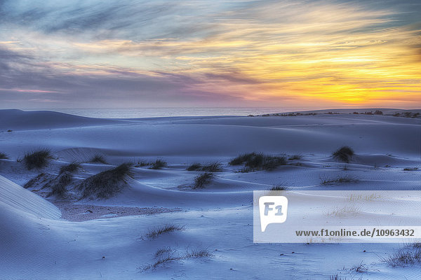 'Sunset over the white sand dunes in Namakwaland National Park; South Africa'