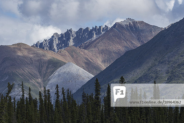 'Colourful mountains along the Wind River in the Peel Watershed; Yukon  Canada'