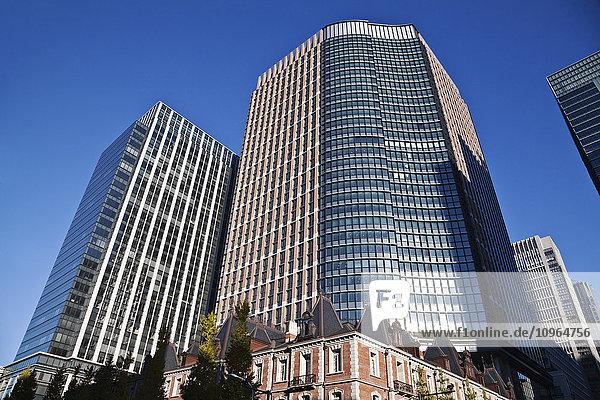 'Skyscrapers against a blue sky; Tokyo  Japan'