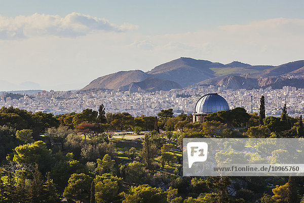 'Dome roof and cityscape with mountains in the distance; Athens  Greece'