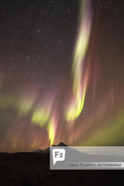 'Northern Lights (aurora borealis) over top of Angelcomb Peak  Dempster Highway; Yukon  Canada'