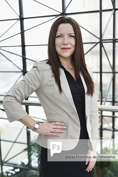 'Portrait of a mature business woman in the atrium of an office building; Edmonton  Alberta  Canada'