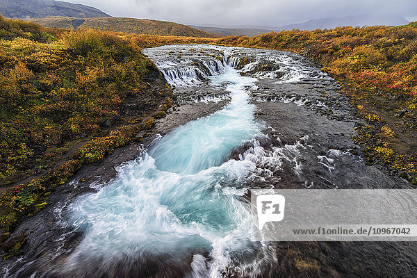 'Waterfall and flowing water in a river; Bruarfoss  Iceland'