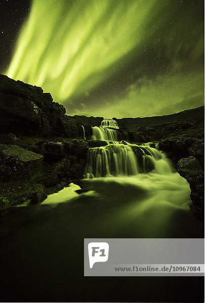 'Northern lights over Dynjandi in the Westfjord region of Iceland  Dynjandi is a series of seven waterfalls; Westfjords  Iceland'