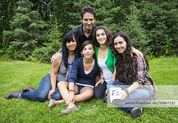'Portrait of a family with three daughters; Sherwood Park  Alberta  Canada'
