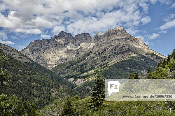 'Scenic mountain view along the red rock canyon road  Waterton Lakes National Park; Alberta  Canada'