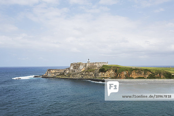 'Lighthouse and cliff; San Juan  Puerto Rico'