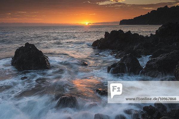'Sunrise and surf over rocks; Hawaii  United States of America'