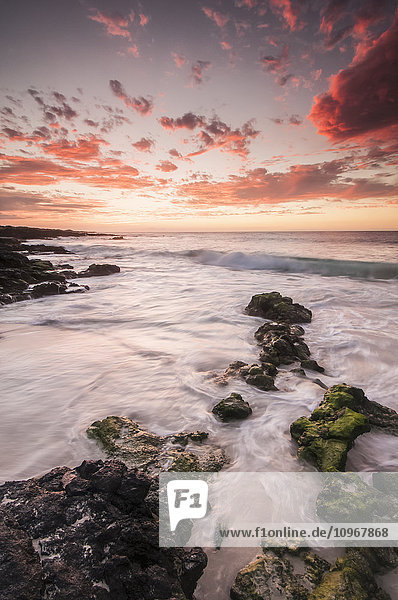 'Vivid pink clouds dominate the sky after sunset in this view from the Kona-Kailoa coast; Island of Hawaii  Hawaii  United States of America'
